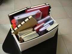 Box of Circa and Moleskine notebooks