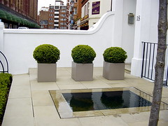 NOT so Private a Garden (londonconstant) Tags: uk england reflection london pool architecture garden private landscape topiary knightsbridge patio gb landscapedgarden londonconstant faves15faves
