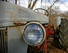 American Heritage (FotoEdge) Tags: old tractor ford grass work farm quality steel memories rusty kansascity missouri rusted cutting headlight plow hay gasoline fieldwork crusty oldtime tiretracks bigeye imprints americanheritage jobone