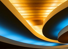 Smooth Curves (Todd Klassy) Tags: travel blue light orange abstract color colour college uw beautiful lines yellow horizontal wisconsin architecture outdoors design memorial colorful university glow moody technology shadows view geometry contemporary union curves smooth shapes angles surreal style ceiling lookingup madison diningroom future badgers glowing form flowing copyspace shape dreamlike universityofwisconsin hue wi luminous outofthisworld futuristic dramaticlighting progressive stylish linear sweeping memorialunion studentunion stockphotography calendarphoto geometricshapes uwmemorialunion uwcampus oncampus designelement colorimage uwmemorialunionterrace aroundmadison madisonphotographer madisonarchitecture wisconsinarchitecture thelakefrontonlangdon studentdining toddklassy