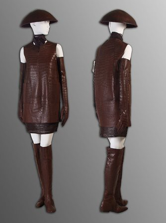 Chocolate brown alligator tunic worn with an embroidered silk scarf Chado Ralph Rucci, Haute Couture fall/winter 2004, Collection of Susan Casden. Black silk marquisette skirt trimmed with chocolate brown alligator strips. Ensemble worn with chocolate brown alligator hat, boots by Manolo Blahnik for Ralph Rucci and gloves by Daniel Storto for Ralph Rucci