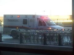 A City of Ottawa ambulance responding to a call at Ottawa Macdonald-Cartier International Airport. (Steve Brandon) Tags: ontario canada geotagged airport ottawa terminal ambulance paramedics emergency ems urgence yow ottawaairport  aroport macdonaldcartier ottawainternationalairport cyow aroportinternationaldottawa ottawamacdonaldcartierinternationalairport fordeseriesambulance paramedicals medicaltechnicians