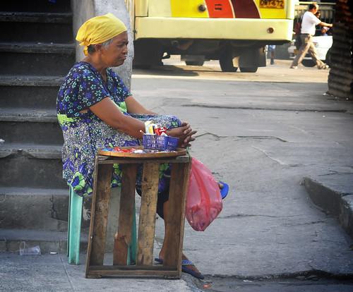 cigarette vendor cubao, quezon city, philippines old lady cigarette vendor sitting stationary side yosi solo alone street