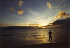 Kaanapali (aspertame) Tags: ocean sunset sky color film beach water silhouette clouds hawaii candid horizon wideangle olympus maui fisheye ethereal olympusom2 om2 sunflare kaanapali singleperson kaanapalibeach