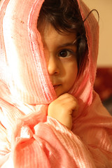 Covering her head (mehmetakifguler) Tags: girl kid child muslim muslimah top20flickrkids bachspicsgallery