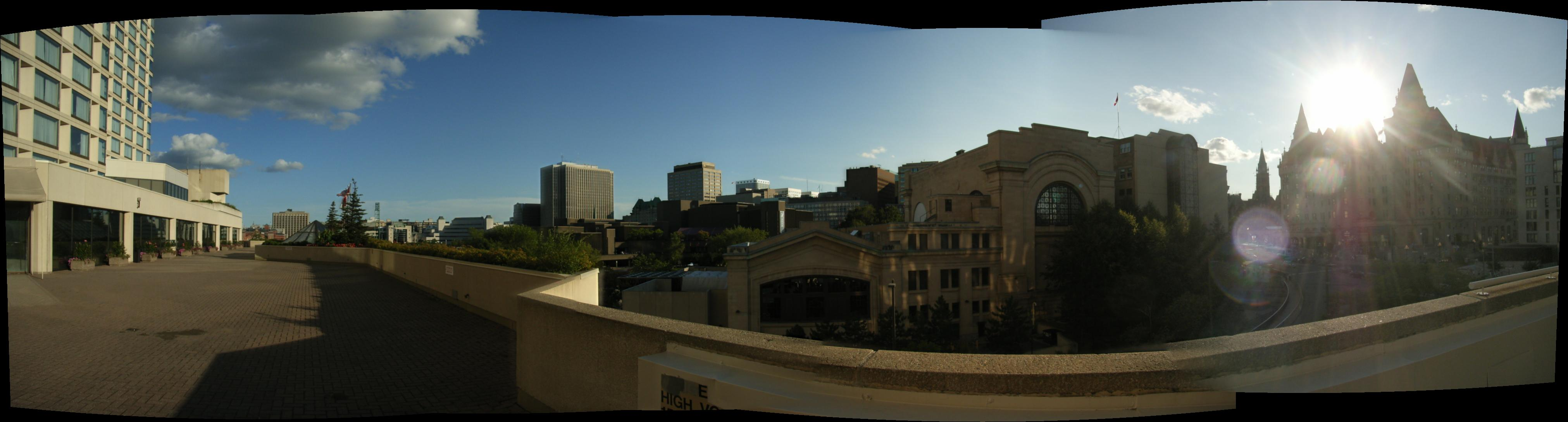 A panoramic view of downtown Ottawa from the Westin Hotel to the Fairmont Chateau Laurier Hotel, taken from the roof of the Rideau Centre.