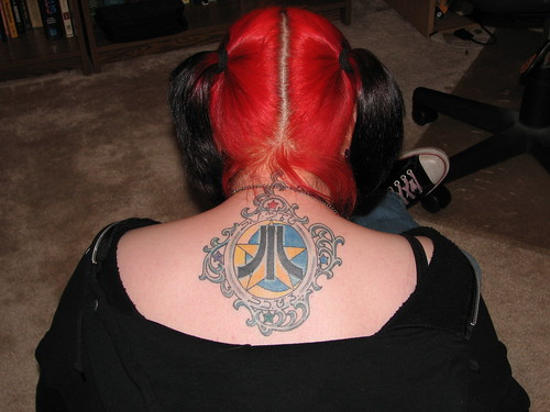 Ornate Atari-and-star tattoo