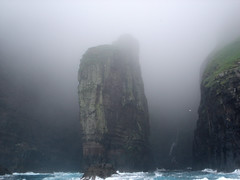 Monolith in the Mist (little_frank) Tags: world ocean travel sea wild vacation cliff nature water beautiful rock vertical fog wonder faro waterfall amazing fantastic europe natural wind north stack atlantic formation wilderness majestic incredible pure monolith viaggio faroeislands breathtaking impressive vacanze scogliera breathless unspoiled faroer monolithic primordial naturesfinest isole froyar faraglione frerne faeroe faero vestmanna faeroerne foroyar froerne frern mywinners faeroer vestmannabjrgini platinumphoto anawesomeshot impressedbeauty ultimateshot superbmasterpiece goldenphotographer diamondclassphotographer flickrdiamond theunforgettablepictures fr betterthangood theperfectphotographer goldstaraward natureselegantshots gnneniyisithebestofday drangur newgoldenseal grnskriudrangur gronskridudrangur