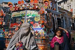 Street scene - Peshawar, Pakistan (Maciej Dakowicz) Tags: travel pakistan woman color bus muslim north hijab western peshawar nwfp frontier burqa burkha prowince