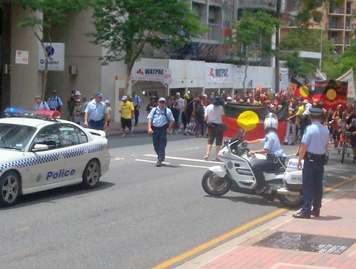 Van of March approaches State Administration Centre, 100 George St - Invasion Day Rally and March, Brisbane, Queensland, Australia 070126