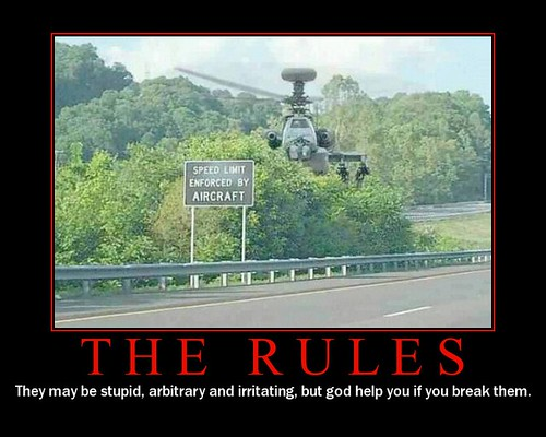 "Picture of a military helicoptor hovering next to a sign that says, ""Speed limit enforced by aircraft."" Underneath the photo it says, ""THE RULES: They may be stupid, arbitrary and irritating, but god help you if you break them."""