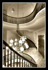 A Banister to Slide On! (sunsurfr) Tags: door wood blackandwhite history monochrome sepia architecture stairs nikon doors capital alabama molding explore chandelier historical montgomery marble d200 banister hdr spiralstaircase spiralstairs photomatrix nikonstunninggallery aplusphoto gaschandelier sunsurfr