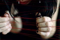 """Suona per me ancora """" (Violator3) Tags: red selfportrait blur colour 1025fav drops hands play 100v10f nikond70s lips womenonly violator3 conceptual nocrop 50mmf14 2007 sonofnoise sucheneineloesung suonapermeancora"""
