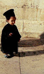BEIT LECHEM - The young monk (BoazImages) Tags: life christmas old city boy black cute church topv111 greek israel cool palestine jerusalem jesus birth monk christian holy arab priest orthodox nativity beitlechem documentry churchofthenativity