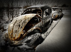 In bad shape ... (asmundur) Tags: two white snow black cold broken car vw pair bad rusty surreal german bent wreck shape mutedcolors hdr dented 3xp photomatix nottoday