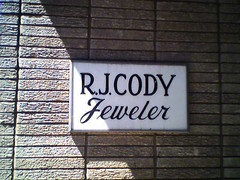 R. J. Cody Jeweler - Sign by door