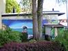 Graffito  an der Wand eines asiatischen Restaurants in Dornbusch (Frankfurt)