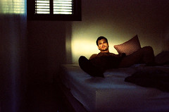 Afternoons in Bed (elbud) Tags: portrait sun selfportrait film home me self canon bed xpro ray afternoon crossing cross room processing date process expired processed e6 eos5 2b crossed dated c41 overdate overdated goldenphotographer platinumheartaward