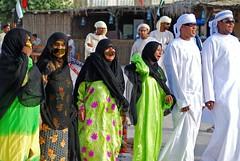 Folk dancing in the Emirates (Samer M) Tags: festival nikon dancing zoom hijab dslr sharjah unitedarabemirates burqa persiangulf arabs midleeast sharja d80