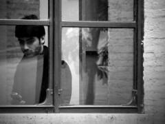 La voce del silenzio (Eugenia Moira Angela Darling) Tags: boy portrait people blackandwhite bw rome roma window bn finestra cellulare telefono ritratto biancoenero vetro ragazzo distratto bibliotecadellorologio