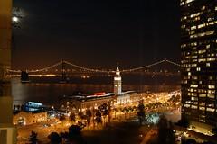 Embarcadero at night (odecurtis) Tags: sanfrancisco california lighting bridge moon night d50 bay nikon baybridge embarcadero ferrybuilding