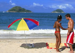 Something wonderful happens in Summer (neloqua) Tags: ocean blue light boy sea summer brazil woman sunlight beach southamerica water girl beautiful riodejaneiro umbrella wonderful wonder fun happy daylight amazing fantastic sand perfect colorful great joy adorable sunny bluesky playa bleu excellent summertime moment lovely charming magical niteroi sunnyday mostbeautifulwoman
