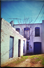 Back Alley (the A.D.) Tags: contrast canon lomo saturated ae1 fake grainy vignette lomofake wilkesboro northwilkesboro weniscrew
