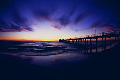 Henley Jetty at Sunset (coopisthehighroller) Tags: ocean sunset sea sky film clouds jetty australia adelaide southaustralia henleybeach nikonf4camerabody fujifilmfujichromevelvia100f afnikkor16mmf28d