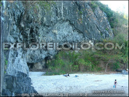 Malumpatan's pebbled shore and small cove