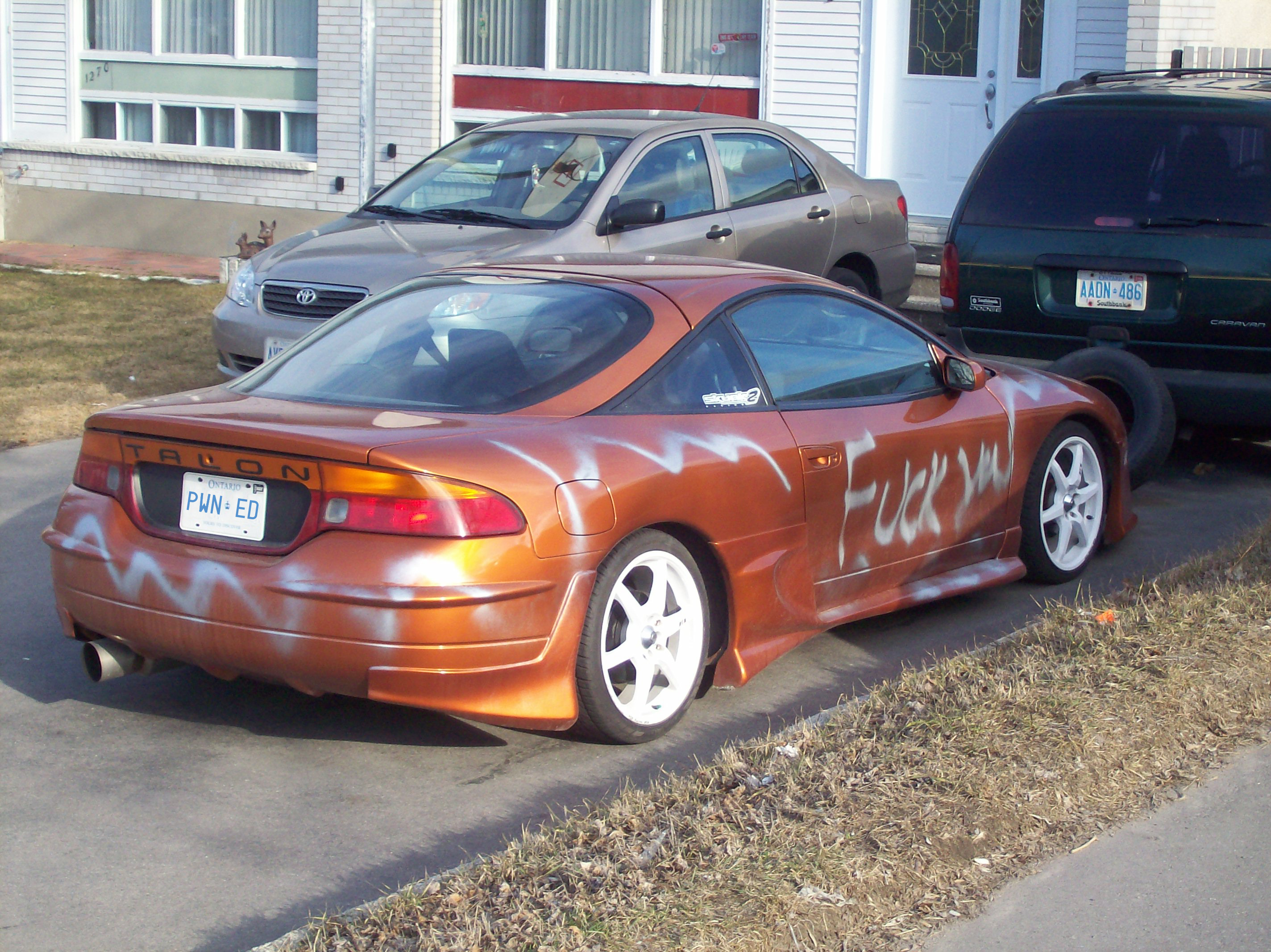A vandalized Eagle Talon.