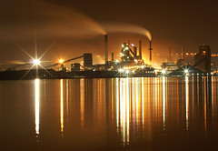 Stelco across the lake (rainypete) Tags: show lake ontario canada reflection mill water lines night reflections dark industrial cityscape bright wind steel smoke hamilton windy creation nighttime smokestack pollution lakeontario 2007 waterreflection stelco hfg manufacturing picturethecure2007 tapics proudhamilton2010