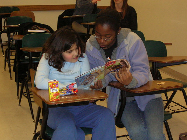 Mentors Reading with Children at Purdue College Mentors for Kids
