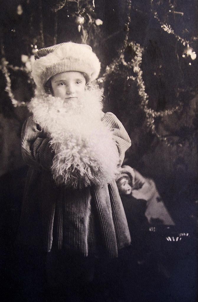 vintage little girl dressed up for christmas time