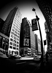 fashion avenue. (adjust the aperture) Tags: city newyorkcity newyork buildings blackwhite cosmopolitan nikon ipod billboard fisheye 7thavenue fashionavenue interestingness45 i500 coolpixp1 impressedbeauty