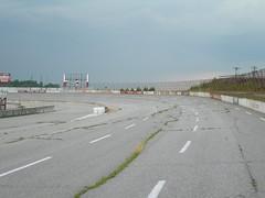 Turn 3 (p2wy) Tags: racetrack race fence geotagged ruins track decay northcarolina racing nascar autoracing wilkesboro oval speedway wilkescounty northwilkesborospeedway p2wy e7600