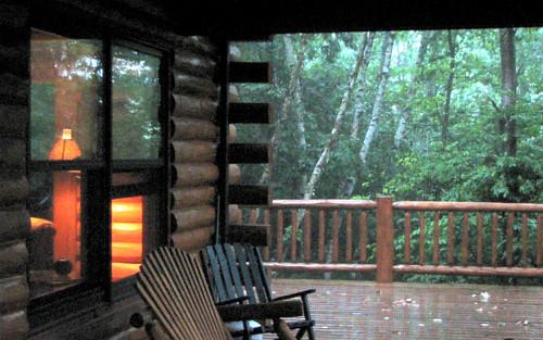 Cabin porch in a summer rainstorm