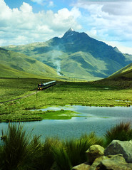 What a Rail Journey! (Trapac) Tags: blue summer lake mountains green film tourism peru southamerica water train landscape gold view kodak cusco scenic olympus tourists valley andes locomotive railways railwayline valleys kodakgold fertile perurail bfbeforeflickr thesacredvalley olympusmjuvallweather agreefee flickrcollectionongetty tracypackerphotography wwwtracypackercom