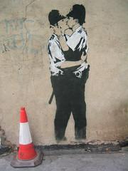 banksy's kissing policemen (squeezemonkey) Tags: streetart london graffiti stencil kissing soho banksy trafficcone policemen