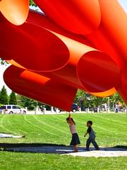 Sculpture w/kids (glueslabs) Tags: seattle red vacation sculpture grass kids tubes seattlecenter