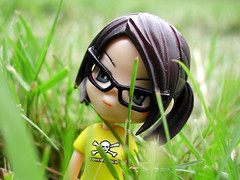 kitten in the grass (zannah) Tags: macro cute topf25 grass closeup toys glasses topf50 doll dof pinky actionfigures kawaii surprise top20toy pinkyst pinkystreet top20hallfame ponytails superlovers jungly babysue vanceproject
