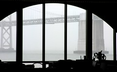 Overcast Bay Bridge (Thomas Hawk) Tags: sanfrancisco california bridge windows blackandwhite bw usa window silhouette architecture dark blackwhite office unitedstates 10 unitedstatesofamerica financialdistrict ferrybuilding through fav10