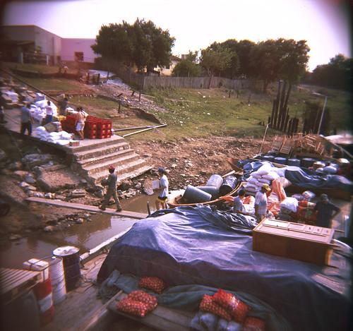 Unloading goods, Guarani, Rio Paraguay