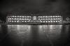 Bright lights : dark nights (Dafydd Penguin) Tags: bright lights after dark architecture llyods bank building wheel slow shutter speed long exposure tripod bristol harbourside harbour port dock square monochrome blackandwhite blackwhte bw black white urban central sky nikon df nikkor 16mm af f28d fisheye