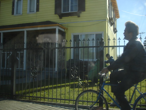 riding past the yellow house