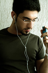 (The Art of) Listening (Mohammed Nairooz) Tags: blue light portrait music art self relax glasses ipod natural outdoor uae khaki bodylanguage listening sharjah earphones 2007 nairooz