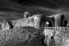 Corfe Castle, Dorset (Jam - 3songsnoflash.co.uk) Tags: england blackandwhite bw castle monument canon eos ancient ruins moody grain somerset dorset grainy nationaltrust hdr westcountry 30d corfecastle photomatix 5xp efs1755