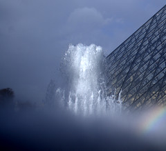 Elements (brun_o) Tags: blue light sky paris france water fountain glass lines clouds rainbow movement pyramid wind fuzzy louvre air pyramide contours