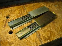 Drawer slides, riveted together.