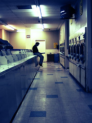 Solitude (*Tiny Dancer*) Tags: man television reading tv crossprocessed long nick aisle lonely laundromat depth dryer washer