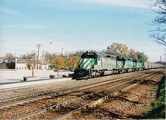 Westbound Burlington Northern Rr unit coal train. Hindsdale Illinois USA. October 1989.